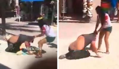 '¡Me traicionaste!': joven arrastra a su novio en plena zona hotelera (VIDEO)